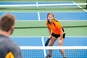 A couple playing pickleball